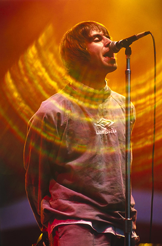 Oasis play Maine Road, Manchester, 27 Apr. 1996Photo by Mark Allan